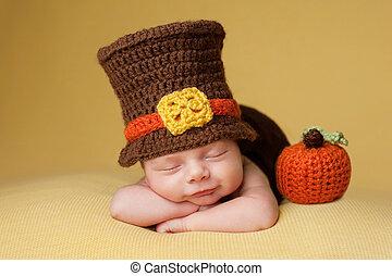 Smiling Newborn Baby Boy Wearing a Pilgrim Hat - Smiling...