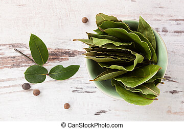 Bay leaves. - Bay leaves on white wooden textured...