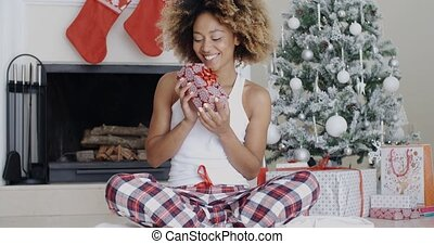 Happy young woman holding her Christmas gift - Happy young...