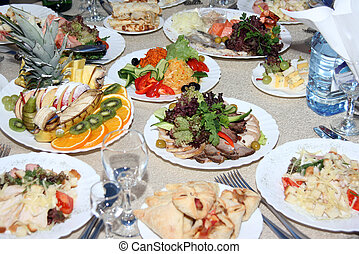 covered table - Festively covered table, with various dishes...