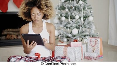 Young woman attending to Xmas social media - Trendy young...
