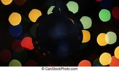 Christmas ball rotates at background of bokeh - Christmas...