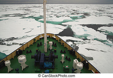 Research vessel in icy arctic sea on