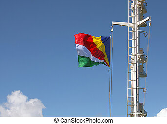 Closeup of Seychelles flag streaming in the wind on the mast...