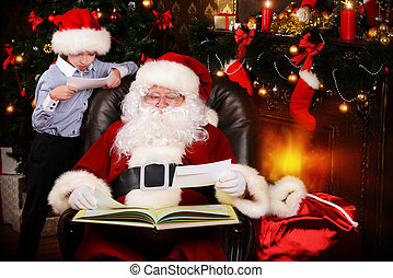 x-mas mail - Little boy and Santa Claus reading letters from...