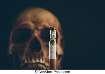 Burning cigarette with skull - Cigarette burning with human...