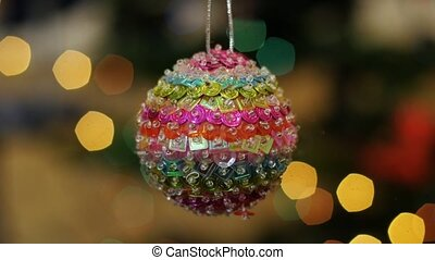 Christmas colorful ball shakes at background bokeh