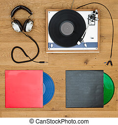 Vinyl records, record player and head phones background - A...