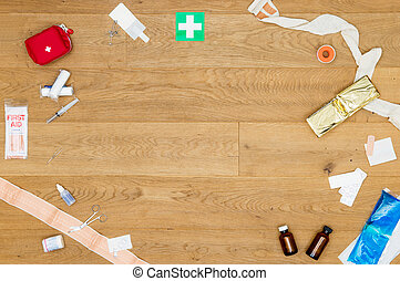 Array of first aid kit objects on wooden surface with copyspace