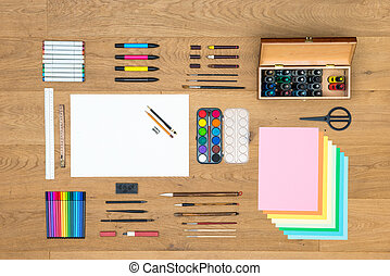 Arts, drawing and design background on wooden surface -...