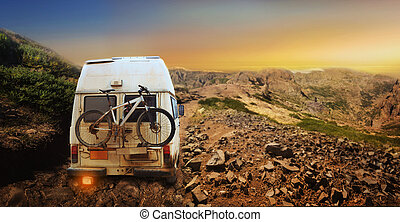 Truck with bicycle - White truck with mountain bike in the...