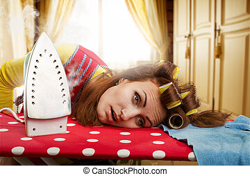 Tired housewife with ironing-board - Tired housewife lying...