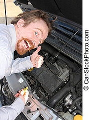 checking engine oil dipstick - happy man checking engine oil...