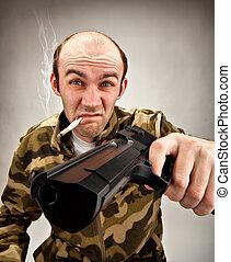 Impudent bandit with gun - Smoking impudent bandit with gun