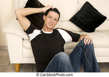 spare time - young and beautiful men is relaxing during his...