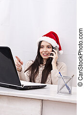 girl with phone and computer in Christmas