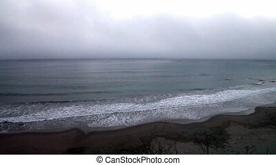 Wide Shot Of Waves On Foggy Beach - Fog Bank Clouds Off...