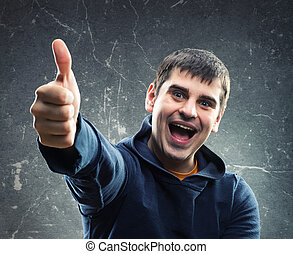 Young man giving thumb up