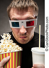 Funny man watching 3D movie