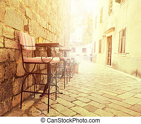 Outdoor cafe chairs in old lane of Montenegro