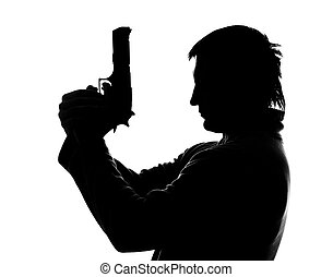 Silhouette of shooting man - Silhouette of man with gun...