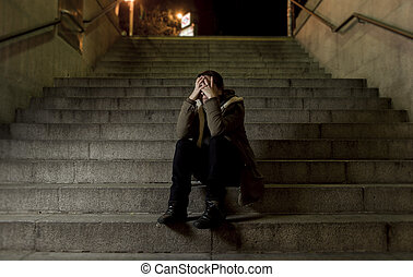 sad woman alone on street subway staircase suffering...