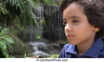 Preteen Hispanic Boy at Waterfall