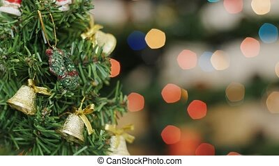 Christmas tree at background blurred night lights -...