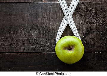 Diet and health concept - The image shows apple surrounded...