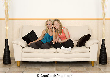 spare time - two young girls taking a phone call and having...