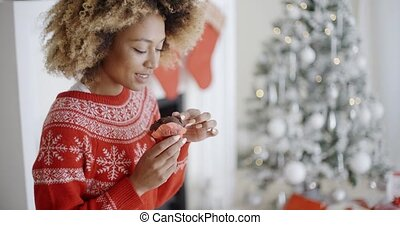 Attractive young woman eating Christmas cake