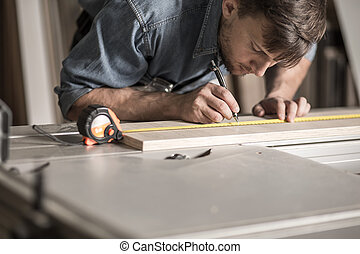 Precise young carpenter during work - Photo of precise young...