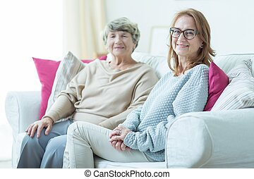 Daughter visiting elder mother