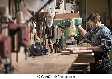 Carpenter using new technology - Picture of skilled...