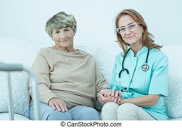 Elder woman and caring doctor - Portrait of elder woman and...