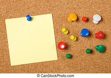 Blank paper note on cork board