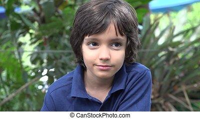 Hispanic Boy Smiling in Nature