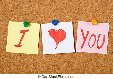 I love You written on paper notes pinned at cork board