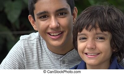 Teen Hispanic Brothers Acting Silly