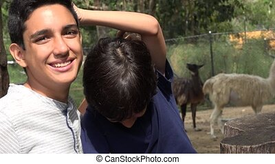 Teen Hispanic Brothers at the Zoo