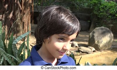 Hispanic Boy at Turtle Exhibit - Preteen Hispanic Boy at...