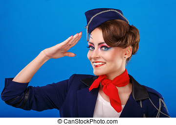 Stewardess with face art salutes Young attractive girl in a...