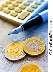 euro coins and pocket calculator - Euro money in office -...
