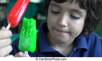 Boy Eating Green Popsicle