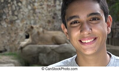 Teen Boy Posing at Lion Exhibit