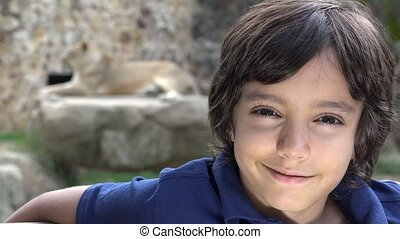 Preteen Boy Posing at Lion Exhibit