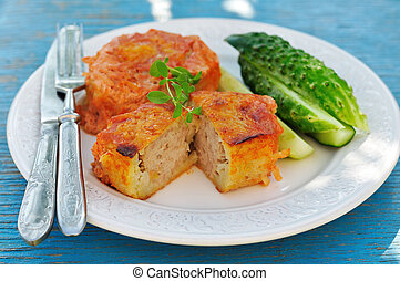 Baked potato cakes stuffed with minced meat kolduny,...