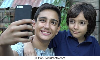 Brothers or Friends Taking Selfie - Teen Brothers or Friends...
