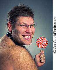 Angry man with lollypop in studio