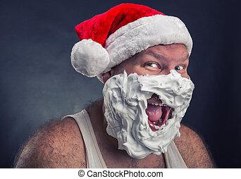 Smiling man in Santa Claus hat - Happy smiling man in Santa...